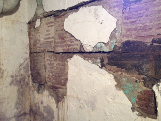 This basement wall has shifting block and bowing due to severe mortar rot & Foundation Replacement - Pioneer Basement Solutions